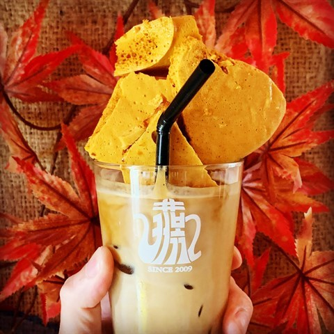 Iced latte topped with dalgona (traditional Korean candy).