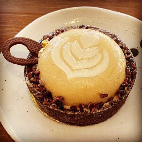 Chocolate sablé, almond cream, dark chocolate coffee ganache, whipped coffee chantilly & cocoa nibs.